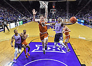 Cartier Diarra #2 of the Kansas State Wildcats drives through the lane to score against Will Baker #50 of the Texas Longhorns during the first half at Bramlage Coliseum on February 22, 2020 in Manhattan, Kansas.