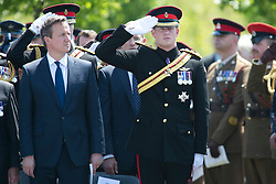 © Licensed to London News Pictures. 11/06/2015. National Memorial Arboretum, Alrewas, Staffordshire, UK. The service to mark the Rededication of the Bastion Memorial. The memorial was begun in Helmand Province in 2006, deconstructed in 2014 and now replicated at the National Memorial Arboretum in Staffordshire. Around two thousand people took part in the service including HRH Prince Harry, the Prime Minister David Cameron and senior members of the Armed Forces. Pictured, Prime Minister DAVID CAMERON and HRH PRINCE HARRY Photo credit Dave Warren/LNP.