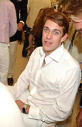 BEN ELLIOT at the 2004 Cartier International polo day at Guards Polo Club, Windsor Great Park, Berkshire on 25th July 2004.