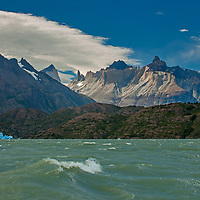 The Horns of Paine and lenticular clouds loom over wave-tossed Grey Lake in Torres del Paine National Park, Chile.