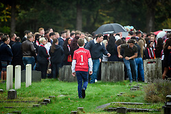 "© Licensed to London News Pictures. 26/10/2017. Epsom, UK. A young boy wearing a Manchester United shirt with ""TOMBOY 1 RIP"" on the back, at the funeral of Tom 'Tomboy' Doherty the nephew of Big Fat Gypsy Weddings star Paddy Doherty, at Epsom Cemetery in Epsom, Surrey. Tom Doherty was 17 when he was killed in a car crash in South Nutfield in Surrey on October 9. He had passed his driving test just days earlier. Photo credit: Ben Cawthra/LNP"