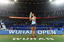 WUHAN, Sept. 30, 2017 Caroline Garcia of France kisses the trophy on the awarding ceremony after winning the singles final match against Ashleigh Barty of Australia at 2017 WTA Wuhan Open in Wuhan, capital of central China's Hubei Province, on Sept. 30, 2017. Caroline Garcia won 2-1. wdz) (Credit Image: © Cheng Min/Xinhua via ZUMA Wire)