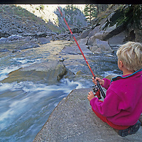 A youngster casts for trout in the Grand Canyon of the Clark's Fork of the Yellowstone River in Wyoming.