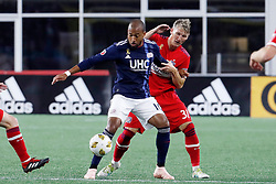 September 22, 2018 - Foxborough, MA, U.S. - FOXBOROUGH, MA - SEPTEMBER 22: New England Revolution midfielder Teal Bunbury (10) holds off Chicago Fire midfielder Bastian Schweinsteiger (31) during a match between the New England Revolution and the Chicago Fire on September 22, 2018, at Gillette Stadium in Foxborough, Massachusetts. The teams played to a 2-2 draw. (Photo by Fred Kfoury III/Icon Sportswire) (Credit Image: © Fred Kfoury Iii/Icon SMI via ZUMA Press)