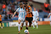 Hull City striker Abel Hernandez (9)  battles with Huddersfield Town defender Martin Cranie (14) during the Sky Bet Championship match between Huddersfield Town and Hull City at the John Smiths Stadium, Huddersfield, England on 9 April 2016. Photo by Simon Davies.