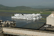 India, Rajasthan, Udaipur view of the Lake Palace hotel, which covers an entire island in the Pichola Lake