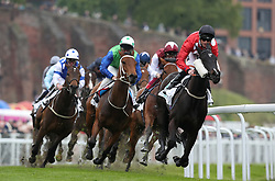 Wanaasah rides by Trevor Whelan leads the field on the first lap of The Arkle Finance Cheshire Oaks, during Boodles City Day at Chester Racecourse, Chester.