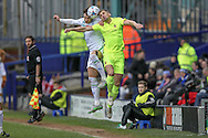 Liam Ridehalgh (Tranmere Rovers) jumps with Mike Phenix (Southport) during the Vanarama National League match between Tranmere Rovers and Southport at Prenton Park, Birkenhead, England on 6 February 2016. Photo by Mark P Doherty.