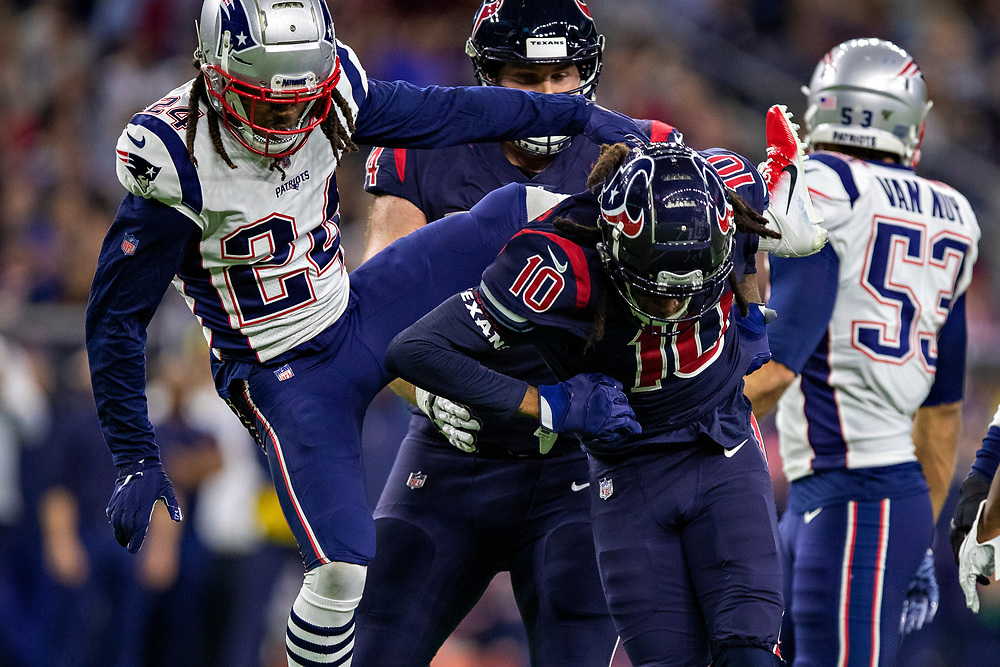 HOUSTON, TX - DECEMBER 1:  DeAndre Hopkins #10 of the Houston Texans stands up with Stephon Gilmore #24 of the New England Patriots on his back during the first half at NRG Stadium on December 1, 2019 in Houston, Texas.   (Photo by Wesley Hitt/Getty Images) *** Local Caption *** DeAndre Hopkins; Stephon Gilmore
