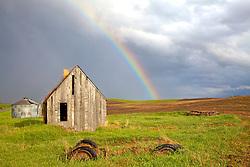 Rainbow over old homestead