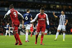 31st December 2017 - Premier League - West Bromwich Albion v Arsenal - Alexis Sanchez of Arsenal looks dejected as he taps hands with teammate Alexandre Lacazette - Photo: Simon Stacpoole / Offside.