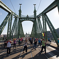 People participate a public Thai chi session during a summer afternoon on a bridge closed for pedestrian traffic only in central Budapest, Hungary on July 15, 2018. ATTILA VOLGYI