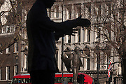 The grasping arms of SouthAfrican President Nelson Mandela's statue with outstretched arm of former Labour politician David Lloyd-George Statues on 18th January 2017, in Parliament Square, London England. The statue of David Lloyd George is an outdoor bronze sculpture of former British Prime Minister David Lloyd George by Glynn Williams. This statue, which stands 8 feet (2.4 m) tall, was unveiled in October 2007 and was funded by the David Lloyd George Statue Appeal, a charitable trust supported in part by HRH The Prince of Wales. The memorial to Nelson Mandela in Parliament Square, London, is a bronze sculpture of former President of South Africa and anti-apartheid activist Nelson Mandela. Originally proposed to Mandela by Donald Woods in 2001, a fund was set up and led by Woods's wife and Lord Richard Attenborough.