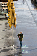 """A a lone man walks by a """"Pedestrian Priority Area"""" sign during COVID-19 in Melbourne, Australia. Hotel quarantine linked to 99% of Victoria's COVID-19 cases, inquiry told. This comes amid a further 222 new cases being discovered along with 17 deaths. Melbourne continues to reel under Stage 4 restrictions with speculation that it will be extended. (Photo by Dave Hewison/Speed Media)"""