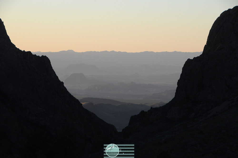 Sunset looking at The Window in Chisis Mountains<br /> Big Bend National Park is a national park located in the U.S. state of Texas. Big Bend has national significance as the largest protected area of Chihuahuan Desert topography and ecology in the United States, which includes more than 1,200 species of plants, more than 450 species of birds, 56 species of reptiles, and 75 species of mammals.