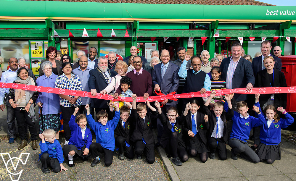 Shailesh Vara MP cuts the ribbon to officially open Matley Post Office surrounded by, from left, Peterborough Council deputy Mayor Councillor John Fox, Councillor June Stokes, Subramaniam Nithaharan, Subramaniam Nithythasan and Councillor Gavin Elsey<br /> <br /> Shailesh Vara MP has cut the ribbon to official opening of the brand new Matley Post Office, part of the Londis Store, Matley, Orton Brimbles, Peterborough. The store is owned by Subramaniam Nithythasan and Subramaniam Nithaharan.<br /> <br /> Date: April 5, 2019