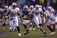 Kansas State tight end Rashaad Norwood (89) rushes up field after a catch, between Florida Atlantic defenders Frantz Joseph (56) and Corey Small (26) in the first half at Bill Snyder Family Stadium in Manhattan, Kansas, September 9, 2006.  The Wildcats beat the Owls 45-0.