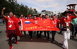 China fans with a flag show their support ahead of the FIFA World Cup 2018, Group A match at the Luzhniki Stadium, Moscow.