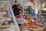 Gjettum, Norway. Family portrait of the Ottersland-Dahl family with one week's worth of food in June. The Hungry Planet project.