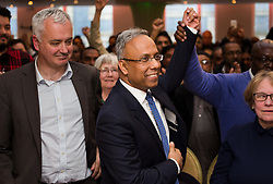 © Licensed to London News Pictures. 01/05/2015. London, UK. Ex Mayor of Tower Hamlets, Lutfur Rahman is welcomed by a cheering crowd at a public meeting held at the Waterlily in Stepney, east London on 30th April 2015. The meeting was ex Mayor of Tower Hamlets, Lutfur Rahman's first public appearance after being found guilty of electoral fraud last week and called for attendees to donate money to a legal fund to facilitate an appeal against the High Court ruling. Photo credit : Vickie Flores/LNP