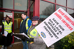 PCS members and supporters in Sheffield stage an eight-hour demonstration to protest  against the planned closure of the local office of the Driver and Vehicle Licensing Agency (DVLA). The protest was called to coincide with a visit to the premises by transport minister Mike Penning.on Monday (23 January) but according to Mike Mackie, assistant secretary of the PCS northern branch for the DVLA, the visit was canceled within 15 minutes of the Sheffield Demo being announced on the PCS website..Shajahan Miah, Mike Mackie and Lauraine Compton..www.pauldaviddrabble.co.uk..23 January 2012 -  Image © Paul David Drabble