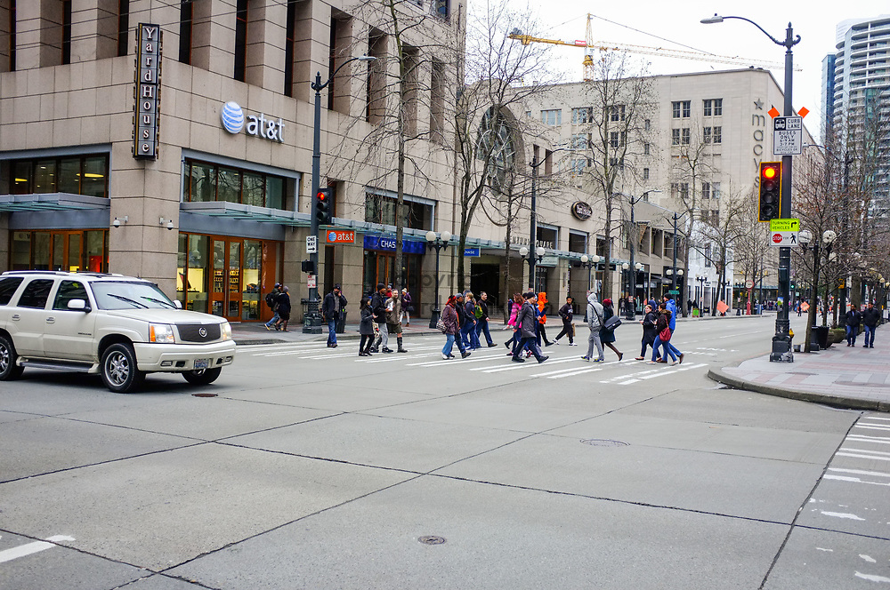 2017 MARCH 05 - People cross 4th Ave at Pike Street, downtown, Seattle, WA, USA. By Richard Walker