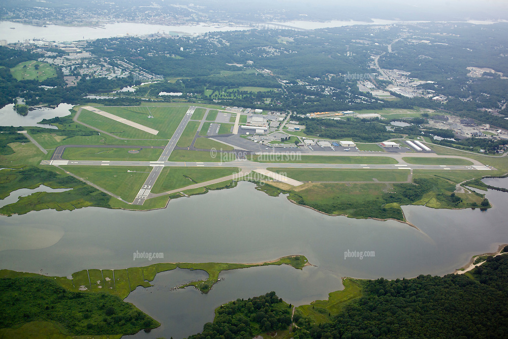 Groton-New London Airport Aerial View. View West, Town of Groton, Thames River and New London CT in background.