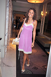 OLIVIA COLE at a dinner hosted by designer Pauric Sweeney held in The Postilion Roon, The Langham, ondon on 23rd June 2009.