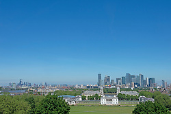 © Licensed to London News Pictures 09/06/2021. Greenwich, UK. A blue sky view across London from the park. Another hot sunny day in Greenwich park, London as temperatures across the UK are forecast to be hotter than Portugal at the weekend. Photo credit:Grant Falvey/LNP