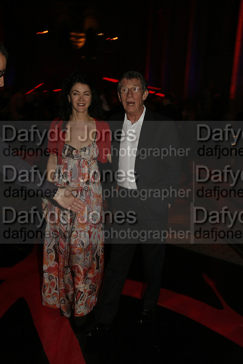 """Mr. and Mrs. John Hurt. UK Premiere of """"V For Vendetta"""" after party in the Royal Courts of Justice. The Strand.  London, 8 March 2006. ONE TIME USE ONLY - DO NOT ARCHIVE  © Copyright Photograph by Dafydd Jones 66 Stockwell Park Rd. London SW9 0DA Tel 020 7733 0108 www.dafjones.com"""
