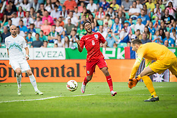 Raheem Sterling of England and Miso Brecko of Slovenia during the EURO 2016 Qualifier Group E match between Slovenia and England at SRC Stozice on June 14, 2015 in Ljubljana, Slovenia. Photo by Grega Valancic