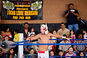 July 13, 2008 -- PHOENIX, AZ: Aguilita Guerrero (the Little Eagle of Guerrero) a tecnico luchador (good guy wrestler) waits in his corner during a Lucha Libre show at El Gran Mercado in Phoenix. Lucha Libre is Mexican style wrestling. There are heros (Tecnicos) and villians (Rudos). The masks are popular as children's gifts and tourist mementos. As the size of the Mexican community in the Phoenix area has grown, attendance at the Lucha Libre shows has increased. Lucha Libre differs from American style entertainment wrestling in several ways, but principally the wrestlers are more acrobatic and rely less on body slams than American wrestling. The shows, which used to be held only periodically, are now held every week at El Gran Mercado, a flea market and swap meet that caters mostly to the Mexican community in Phoenix.   Photo by Jack Kurtz / ZUMA Press