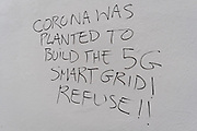 Graffiti on a wall in a Chelsea sidestreet proclaims the connection between the 5G network and the Coronavirus pandemic, on 24th August 2020, in London, England.
