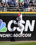 CHICAGO - JULY 01:  Melky Cabrera #53 of the Chicago White Sox leaps but cannot catch the home run ball hit by Elvis Andrus #1 during the game against the Texas Rangers on July 1, 2017 at Guaranteed Rate Field in Chicago, Illinois.  The Rangers defeated the White Sox 10-4.  (Photo by Ron Vesely) Subject:   Melky Cabrera; Elvis Andrus