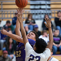 Kirtland Central's Jacoby Love (32) takes a shot under the  basket against Miyamura Thursday night in Gallup.