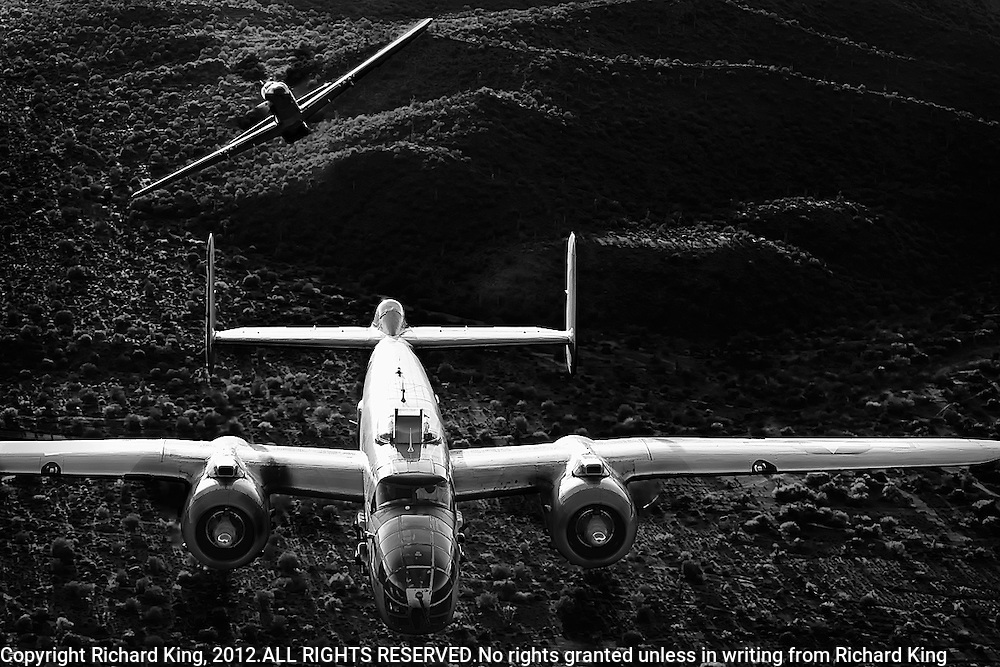B-25 Michell Bomber with p-51 Mustang fighter escort peeling off in black and white photographic fine art print