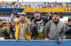 Nov 23, 2019; Morgantown, WV, USA; West Virginia Mountaineers fans cheer during the second quarter against the Oklahoma State Cowboys at Mountaineer Field at Milan Puskar Stadium. Mandatory Credit: Ben Queen-USA TODAY Sports