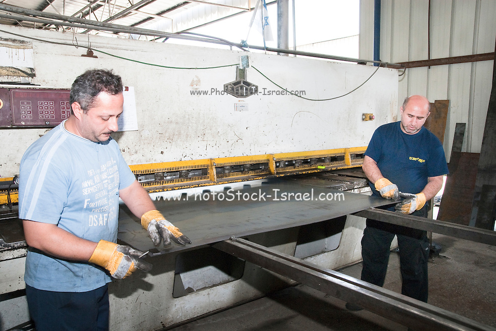 Metal workshop production line Manufacturing a truck cart A press