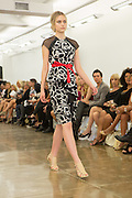 Dress in black and white print with peplum top. By Carmen Marc Valvo at the Spring 2013 Fashion Week show in New York.