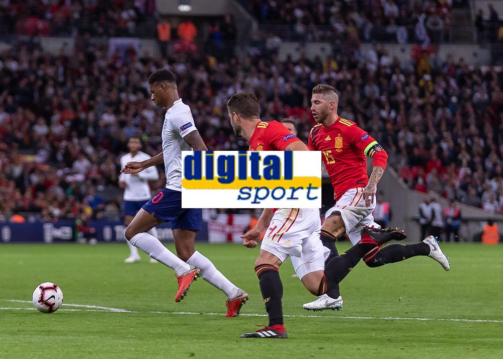 Football - 2018 / 2019 UEFA Nations League A - Group Four: England vs. Spain<br /> <br /> Marcus Rashford (England) breaks away from Sergio Ramos (Spain) and Nacho (Spain) at Wembley Stadium.<br /> <br /> COLORSPORT/DANIEL BEARHAM