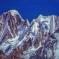 Satellite peaks of Annapurna III rise above Annapurna Sanctuary, Nepal Himalaya.