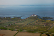 Nederland, Friesland, Gemeente Dongeradeel, 08-09-2009; Holwerd, veerdam (pier) met veerhaven voor veerdienst op Ameland (eiland aan de horizon).Causeway (pier) for the ferry to Ameland (Island on the horizon).luchtfoto (toeslag); aerial photo (additional fee required); .foto Siebe Swart / photo Siebe Swart