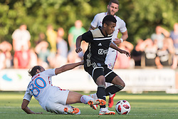 (L-R) Filipe de Andrade Texeira of Steaua Bucharest, David Neres of Ajax during the friendly match between Ajax Amsterdam and Steaua Bucharest on July 7, 2018 at Sportpark Achterveen in Hattem, The Netherlands