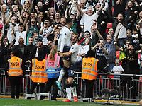 Football - 2018 / 2019 Premier League - Tottenham Hotspur vs. Fulham<br /> <br /> Harry Kane of Spurs celebrates scoring goal no 3 with Erik Lamela, at Wembley Stadium.<br /> <br /> COLORSPORT/ANDREW COWIE