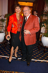ANITA HARRIS and her husband MIKE MARGOLIS at a reception to launch Angel themed Christmas Cards and view an exhibition of the original art work by Gordon King with proceeds going to the Caron Keating Foundation  held at the Langham Hotel, Portland Place, London on 20th November 2006.<br />