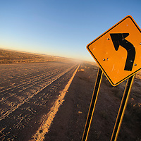 010813  Adron Gardner/Independent<br /> <br /> A sign points the way on the washboard surface of Navajo Route 71 near Winslow Wednesday.
