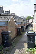 Rubbish bins in back alley of nineteenth century  model worker's housing, Railway Village Swindon, Wiltshire, England, UK