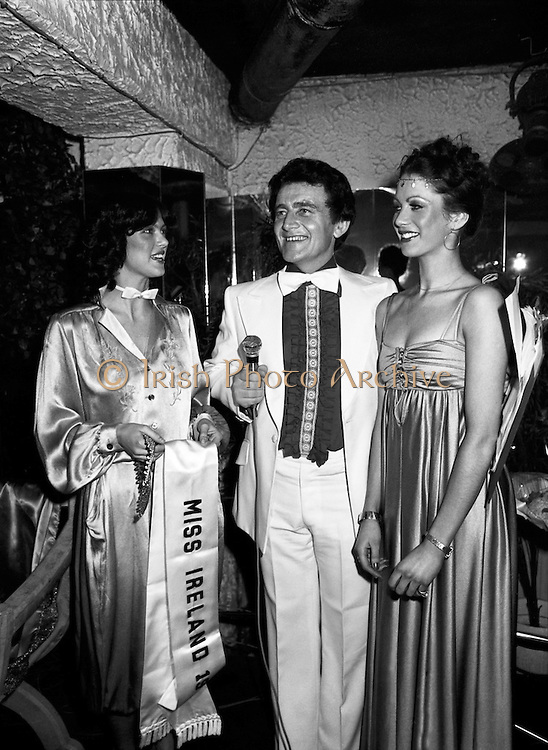 The winner of the Miss Ireland beauty pageant, Lorraine Marian O'Connor (right), about to receive her sash and crown. Centre is compere Larry Gogan.<br />