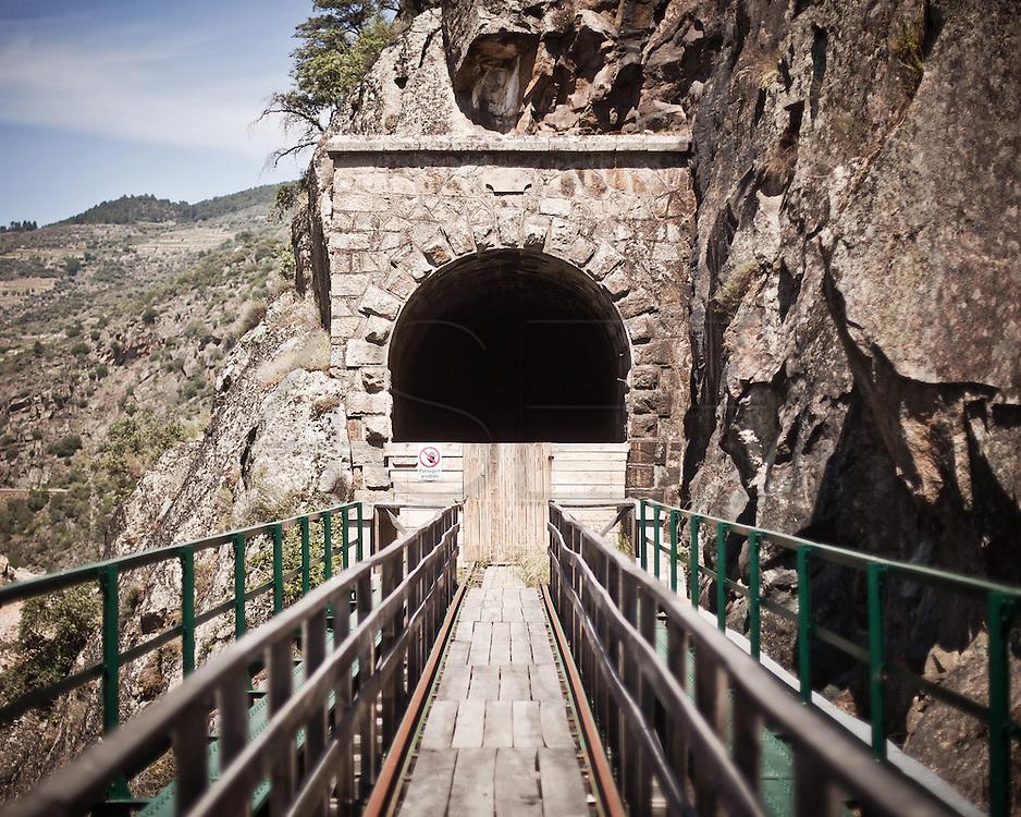 Mirandela<br /> The railway tunnel of the extinct Tua rail line is now used as the yard for the new EDP (the biggest national electricity company) dam.<br /> <br /> Mirandela.<br /> Túnel da extinta linha do Tua usado agora  para estaleiro da construção da nova barragem da EDP.