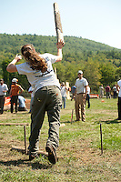UNH team members Amelia  Aznive and Nick Haskell compete in the Pulp Toss event at the 2012 Gilford Bicentennial Woodsman Competition on Sunday.  (Karen Bobotas/for the Laconia Daily Sun)